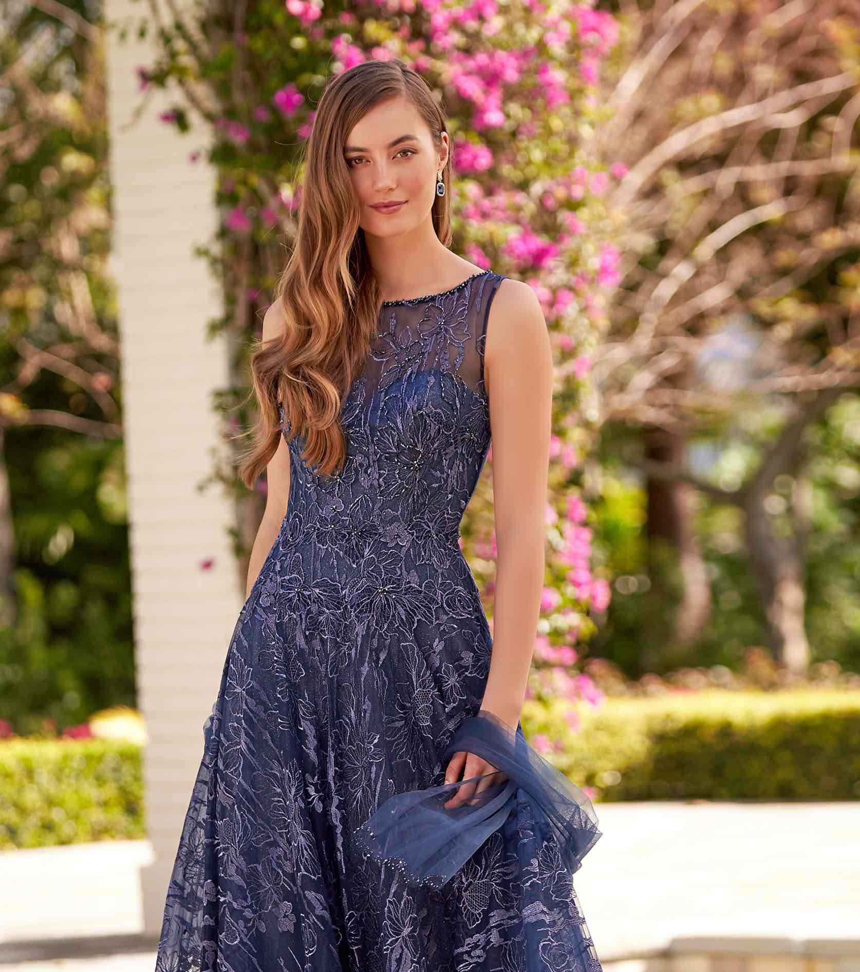Model in blue sparkly Montage gown