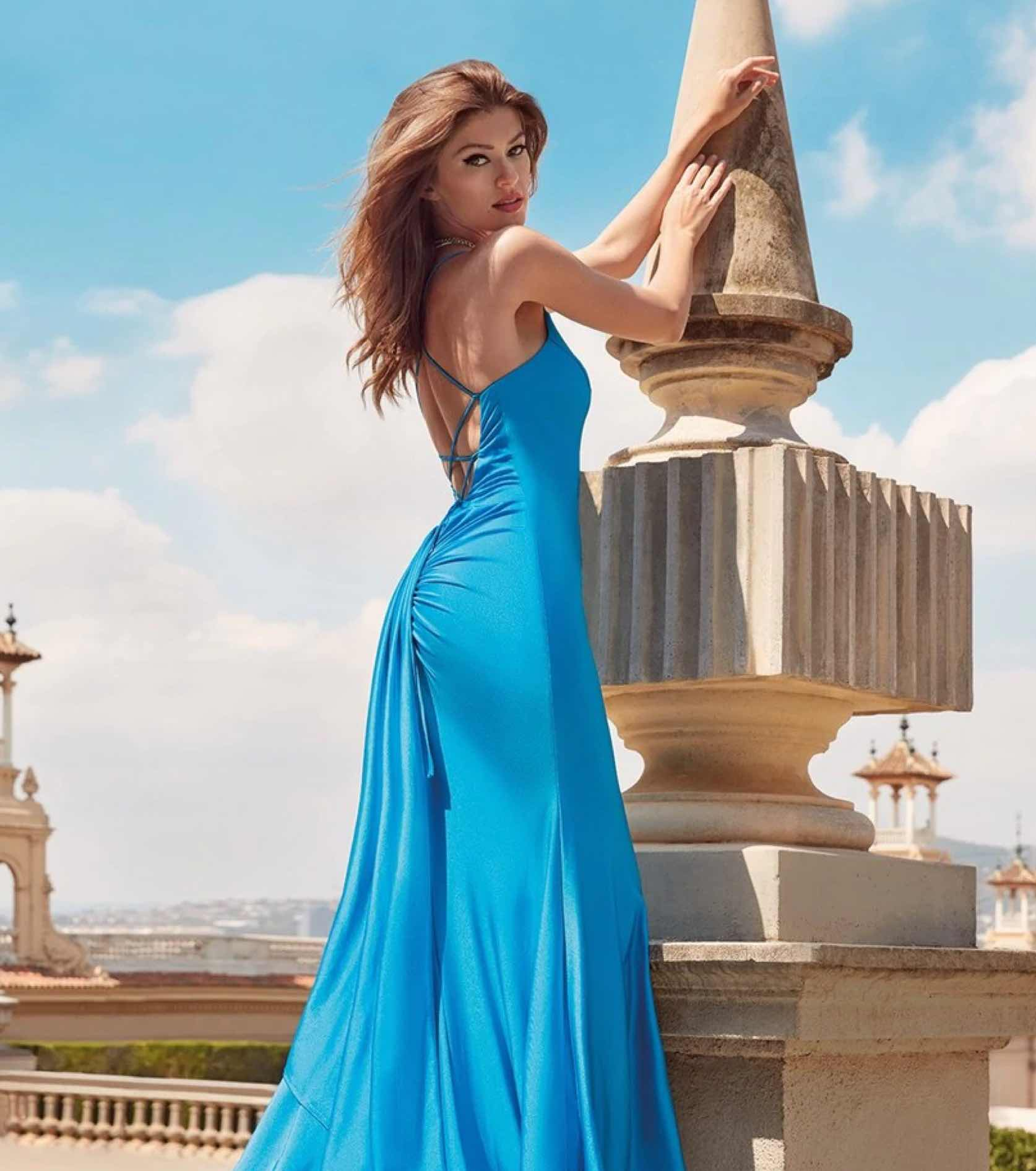 Model in blue Alyce Paris gown