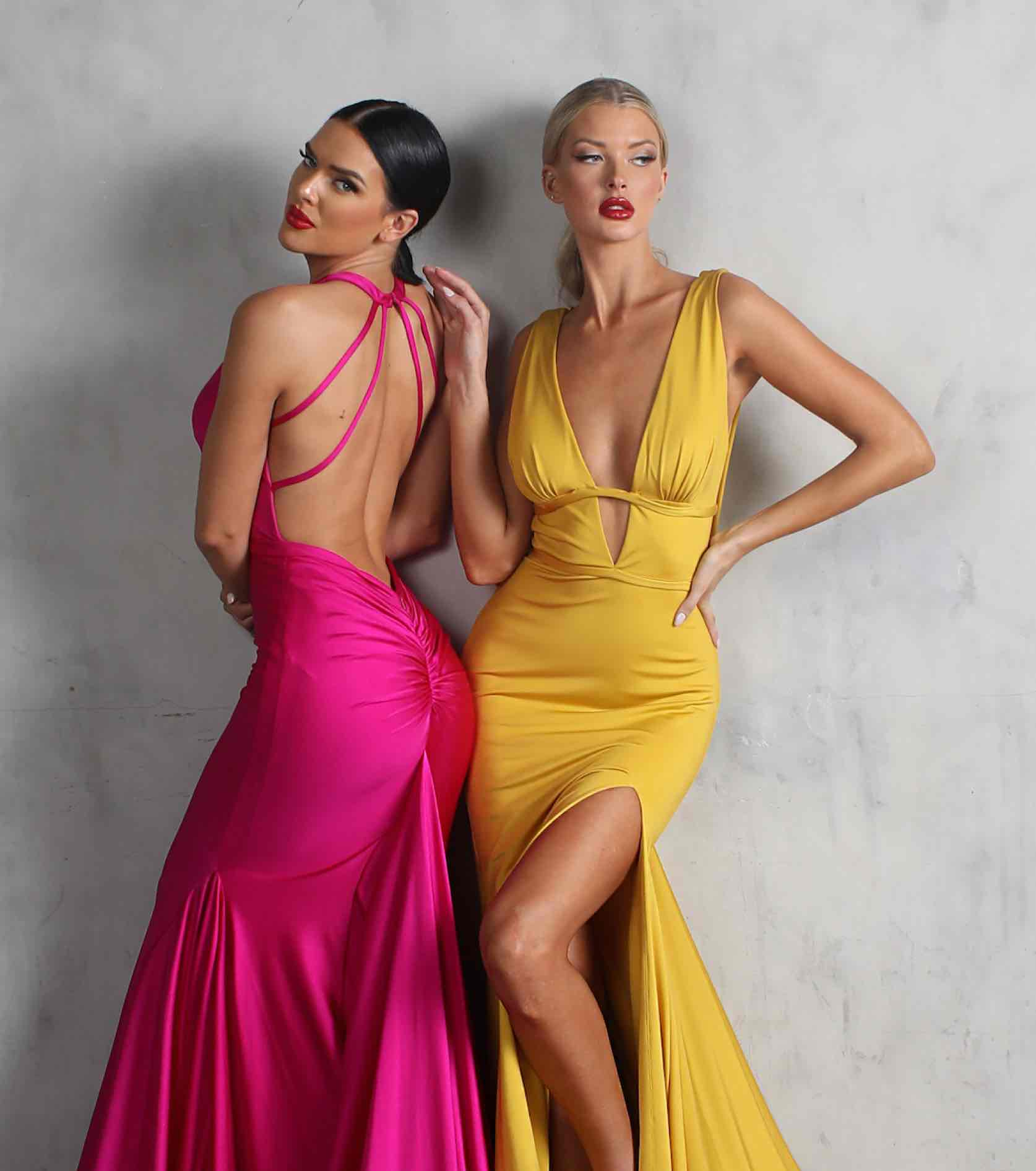 Models in pink and yellow Nicole Bakti dresses