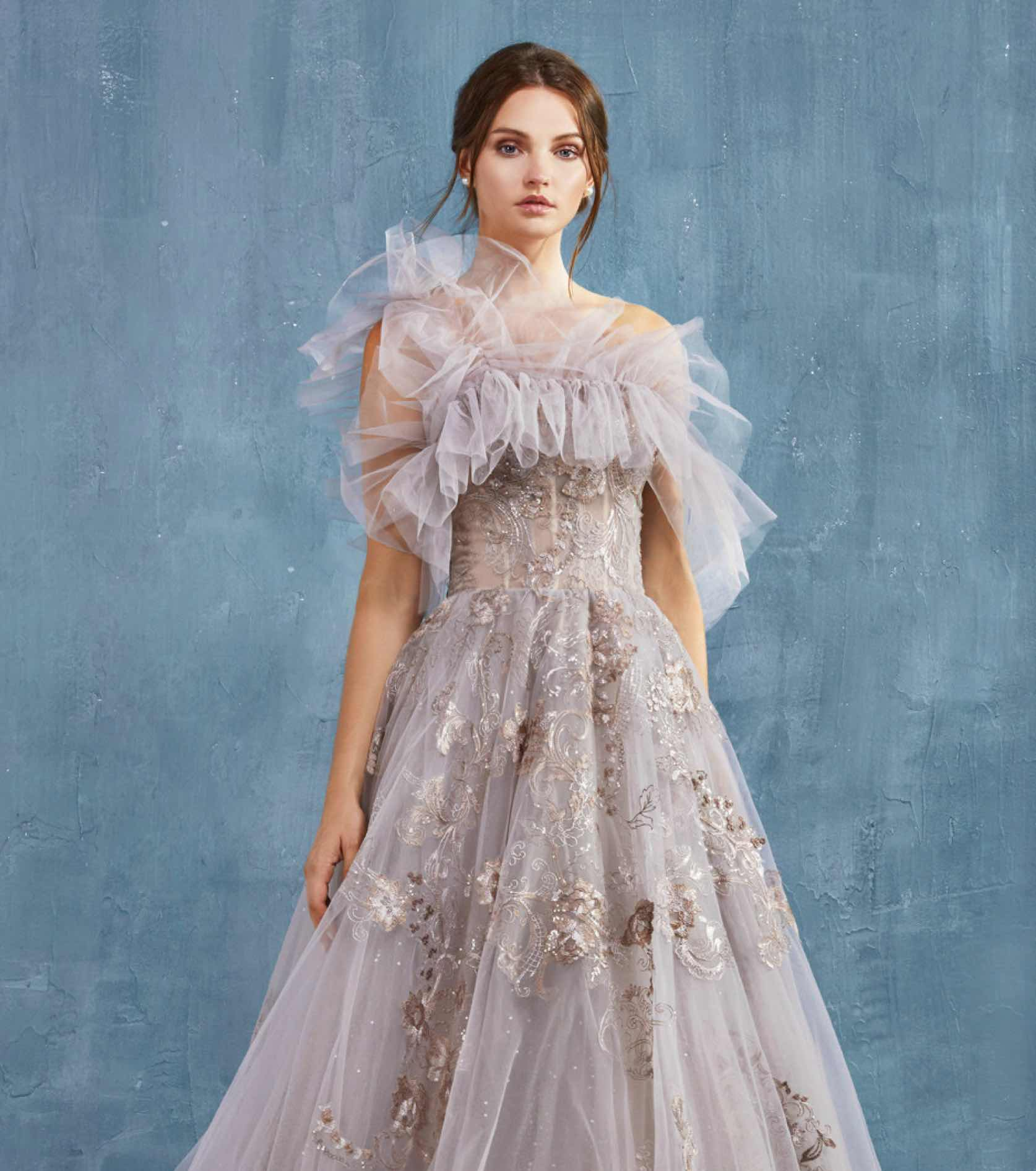 Model in lavender embroidered Andrea and Leo Couture gown