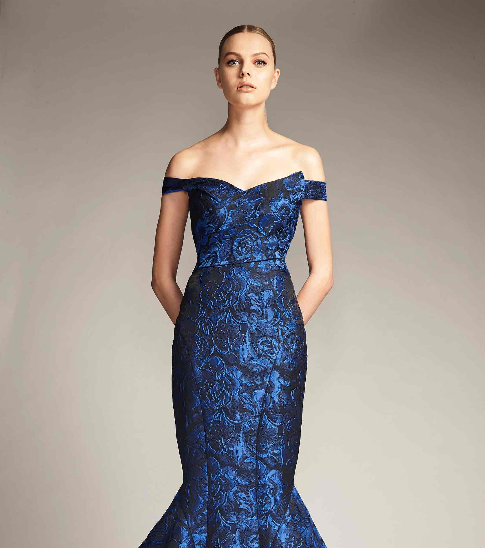 Model in blue patterned off the shoulder Park 108 gown