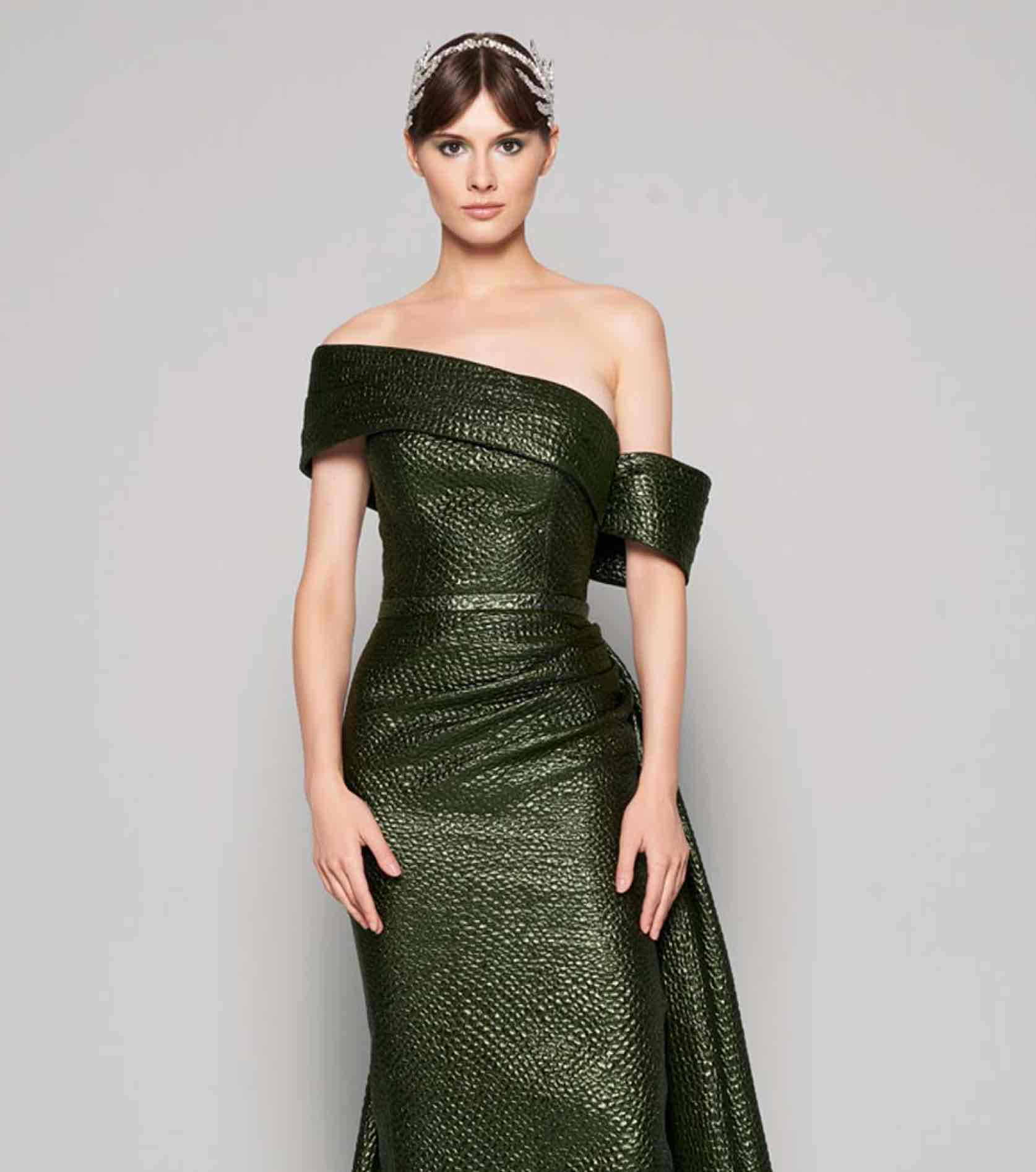 Model in sparkly off the shoulder green MNM Couture gown