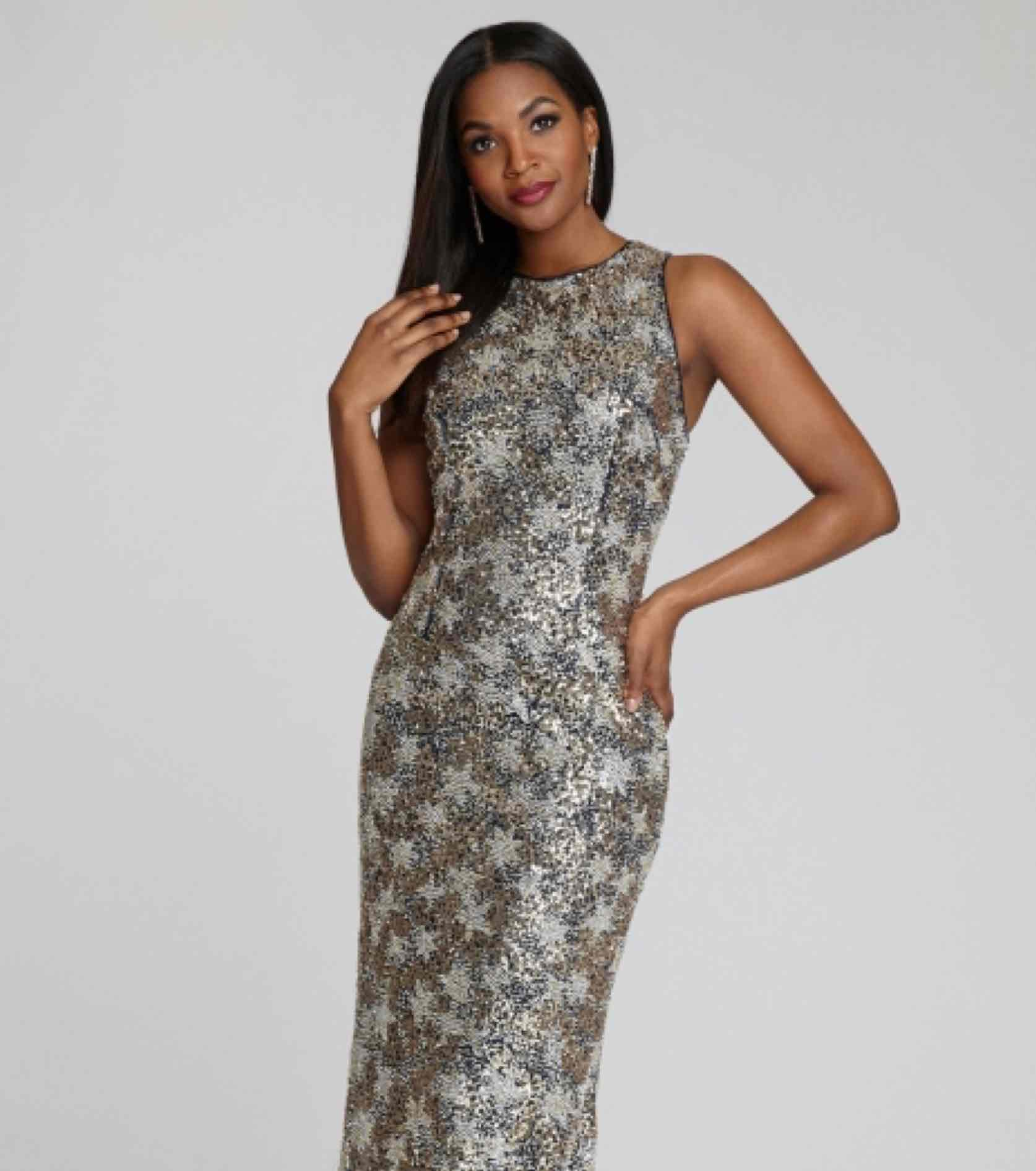 Model in silver shiny star patterned Teri Jon gown