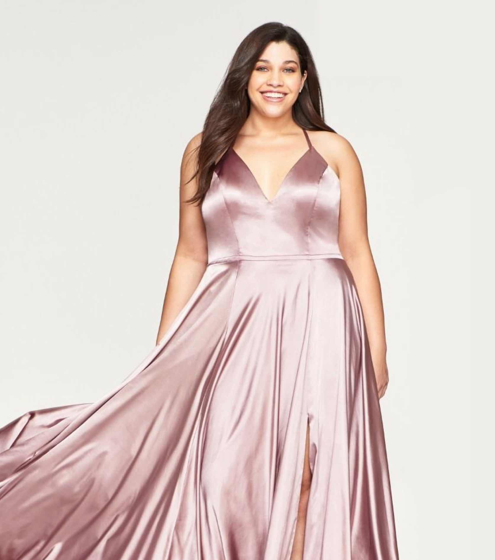 Plus size model in blush satin Faviana dress