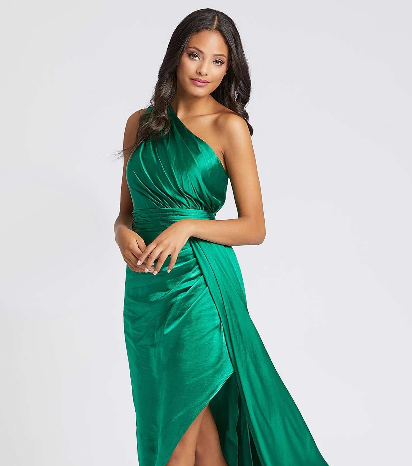 Model in green one shoulder Cassandra Stone gown