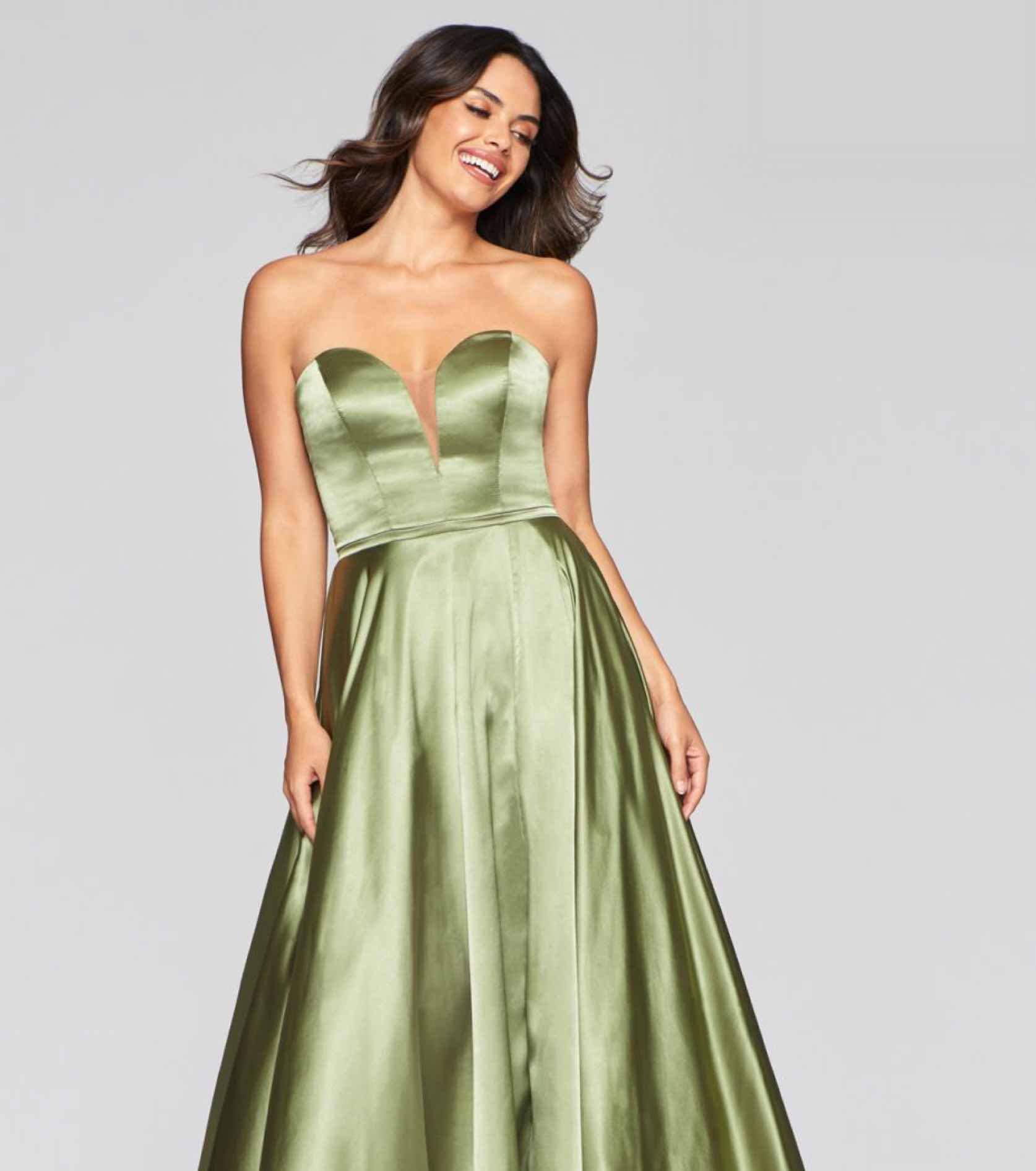 Model in green satin Faviana dresses