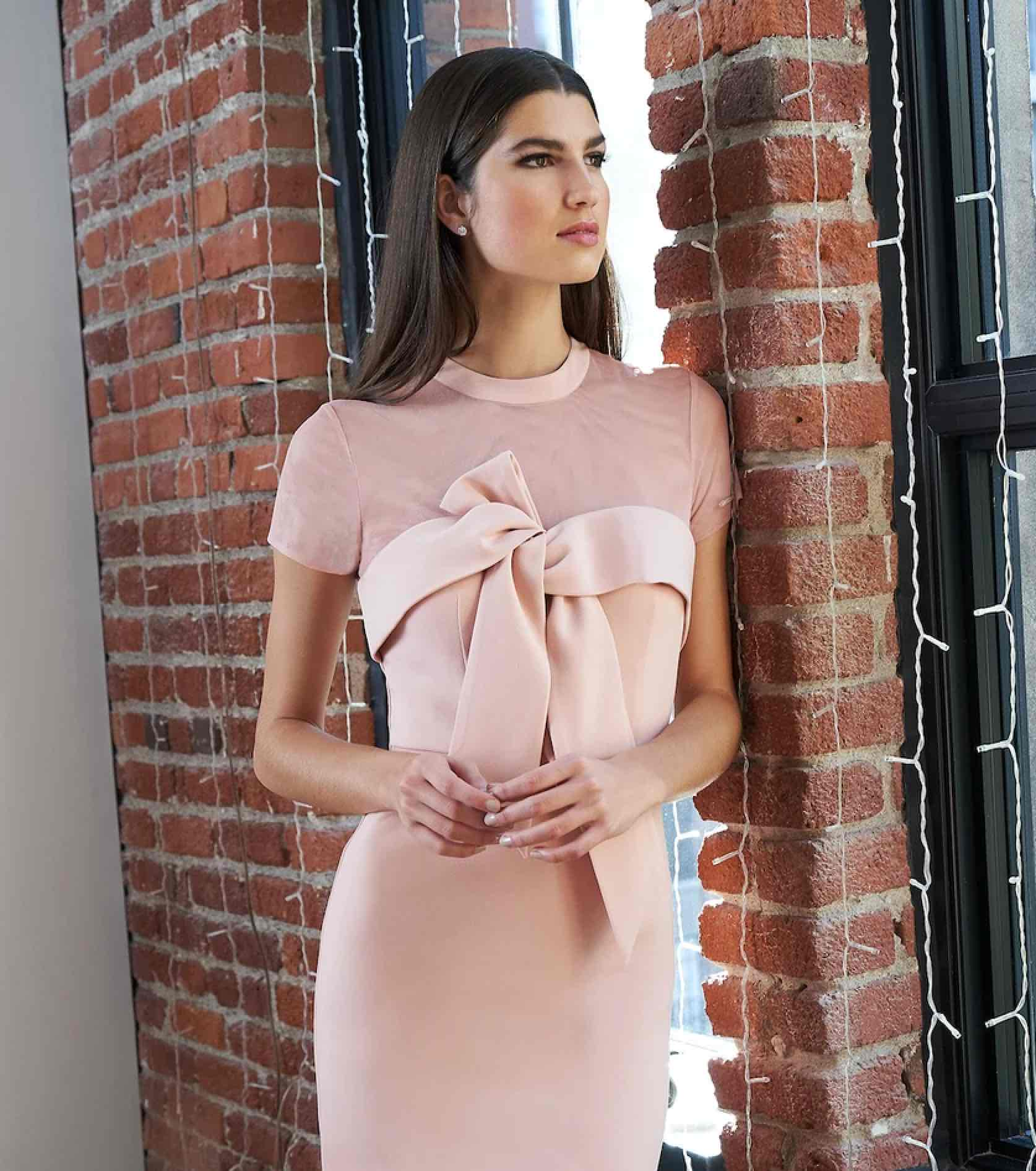 Model in light pink JS Collection dress