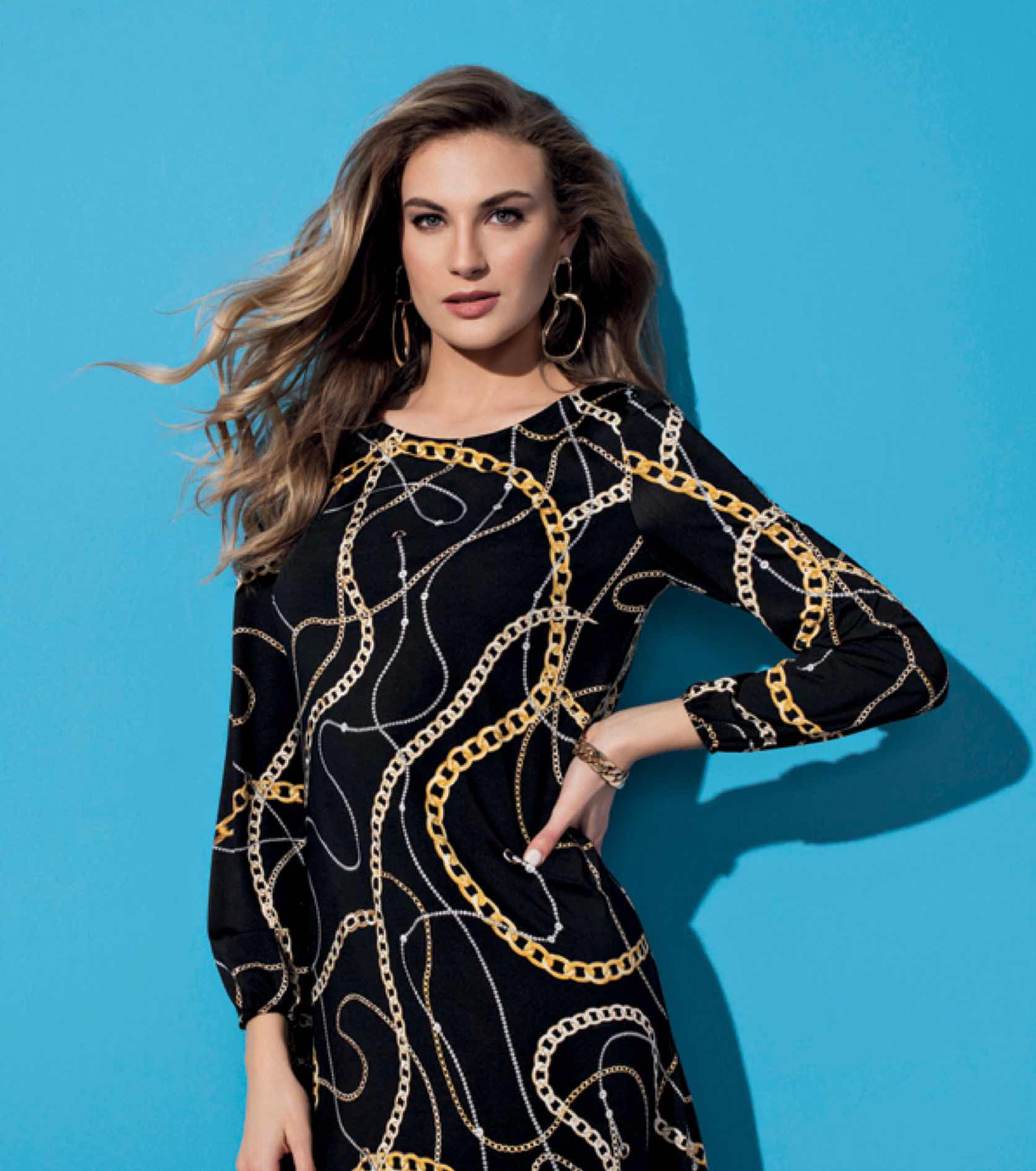 Model in black patterned long sleeve Frank Lyman dress