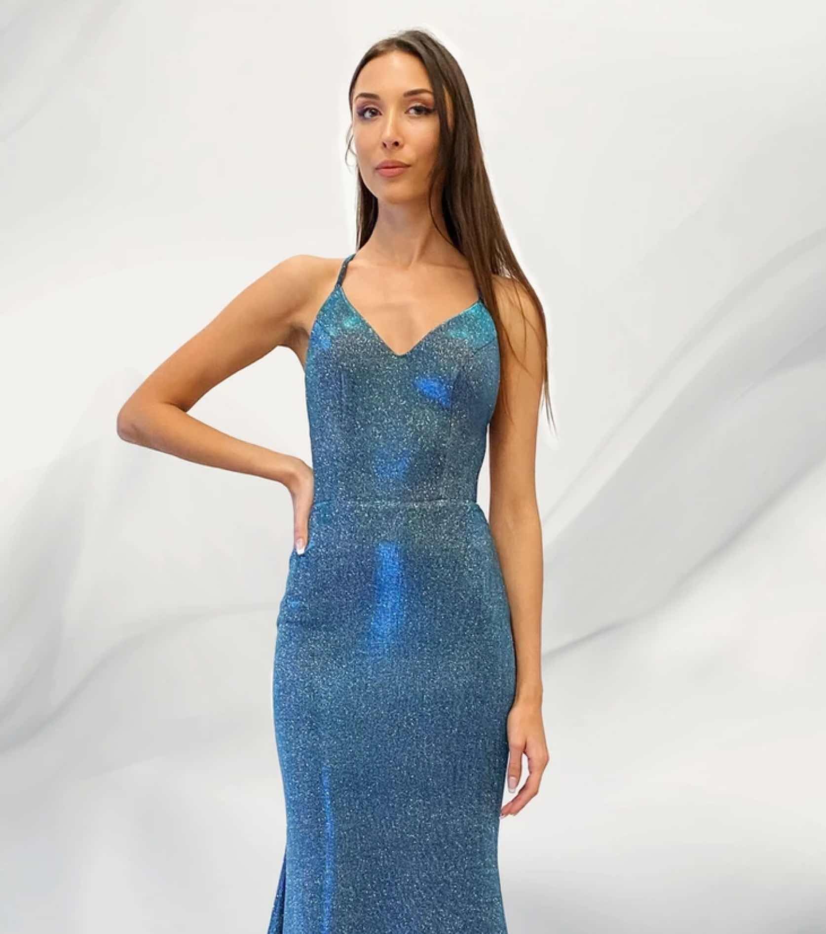 Model in blue sparkly Jessica Angel dress